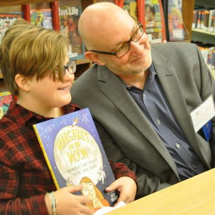 Author Dean Robbins with a fan during book signing.